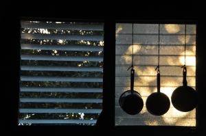 Three pots in a window